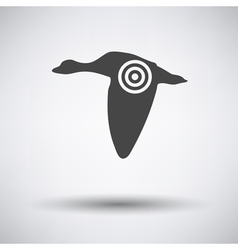 Flying duck silhouette with target icon vector