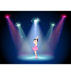 A young ballerina at the center of the stage vector image vector image