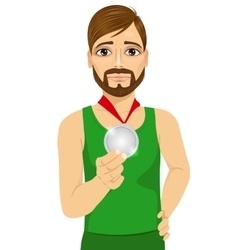 Upset male athlete showing his silver medal vector
