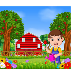 Gardeners man with holding a flower and watering c vector