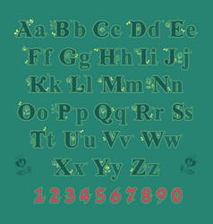 Green alphabet with yellow floral decor vector