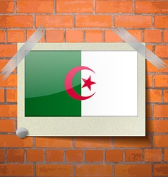 Flags algeria scotch taped to a red brick wall vector