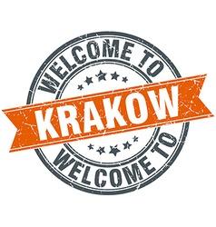 Welcome to krakow orange round ribbon stamp vector