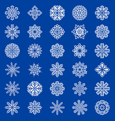 Set of snowflakes on blue background vector