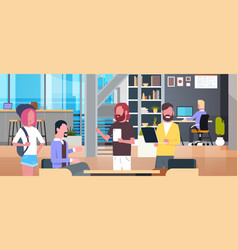 Coworking office interior with casual people vector