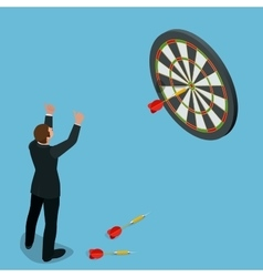 Businessman hitting the center of target aiming vector