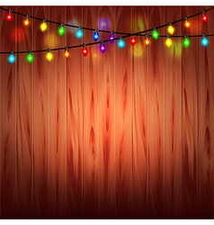 Christmas lights on wood background vector