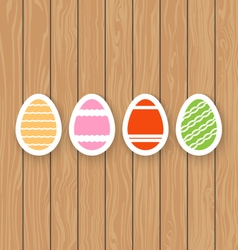 Easter eggs on a wooden background vector