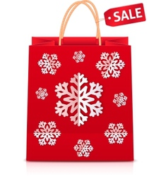 Red christmas shopping bag with paper snowflakes vector