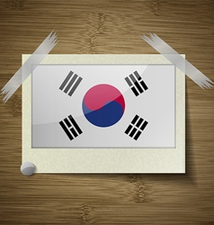 Flags korea south at frame on wooden texture vector