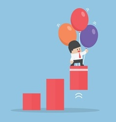 Businessman use balloon to pulled up the graph vector