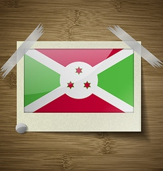 Flags burundi at frame on wooden texture vector
