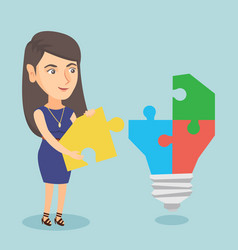 Businesswoman completing lightbulb made of puzzle vector