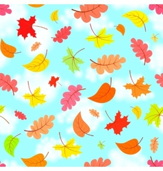 Falling leaves across the blue sky eamless pattern vector