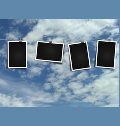 photo frame on rope on sky background vector image