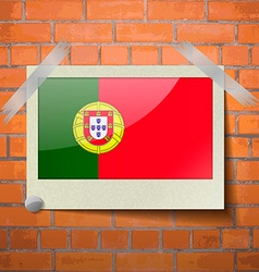 Flags portugal scotch taped to a red brick wall vector
