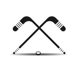 Icon hockey sticks and a puck with shadow vector