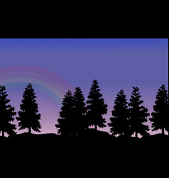 Silhouette of tree lined with rainbow landscape vector