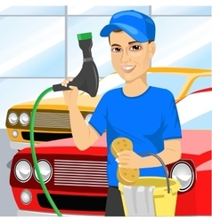 Smiling teen boy washing a car vector