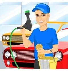 Smiling teen boy washing a car vector