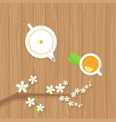 Tea teapot and a branch of the cherry blossoms on vector