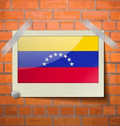 Flags venezuela scotch taped to a red brick wall vector