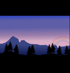 silhouette of big mountain with rainbow vector image