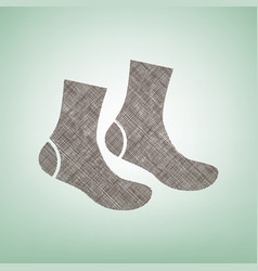 Socks sign  brown flax icon on green vector