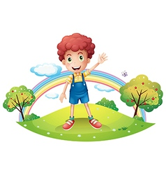 The boy and the rainbow vector image vector image