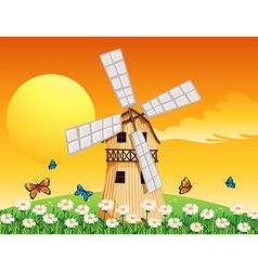 A wooden windmill at the garden vector