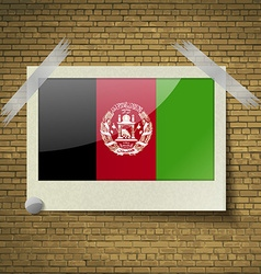 Flags afghanistan at frame on a brick background vector