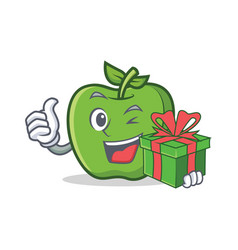 Green apple character cartoon with gift vector