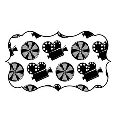 Vintage label with movie camera projector and reel vector