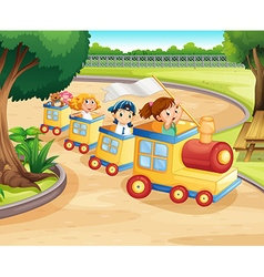 Children riding on the train in the park vector image vector image