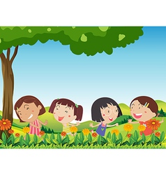 Happy kids playing outdoor near the blooming vector image
