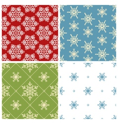 Four christmas seamless patterns vector