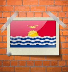 Flags kiribati scotch taped to a red brick wall vector