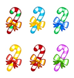 Coloruful candy canes with ribbon vector image