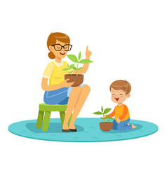 teacher and little boy learning about plants vector image