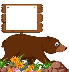 Brown bear cartoon in the jungle vector