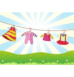 Hanging baby clothes in the hill vector image vector image