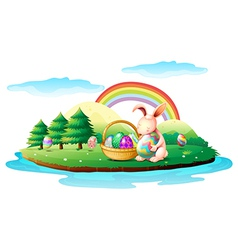 An island with a bunny and a basket of easter eggs vector