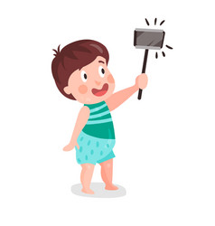 Cute cartoon little boy making selfie with a stick vector