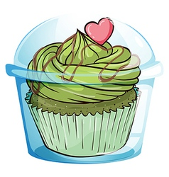 A cupcake with a green icing and a pink heart vector image vector image