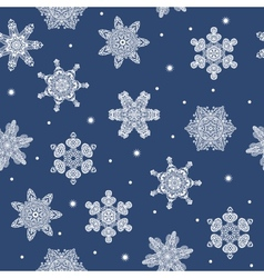 Seamless winter new year snowflakes background vector