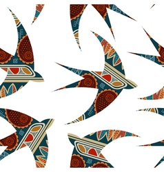 Seamless decorative tribal pattern with swallows vector