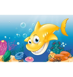 A yellow shark smiling under the sea vector image vector image