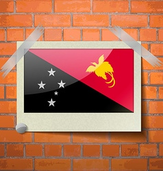 Flags papua new guinea scotch taped to a red brick vector