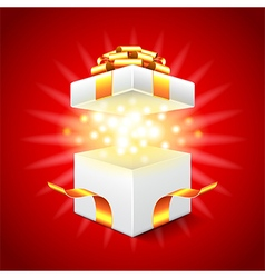 Opened gift box on red background vector image vector image