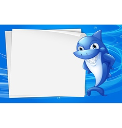 A blue shark beside an empty paper under the water vector image
